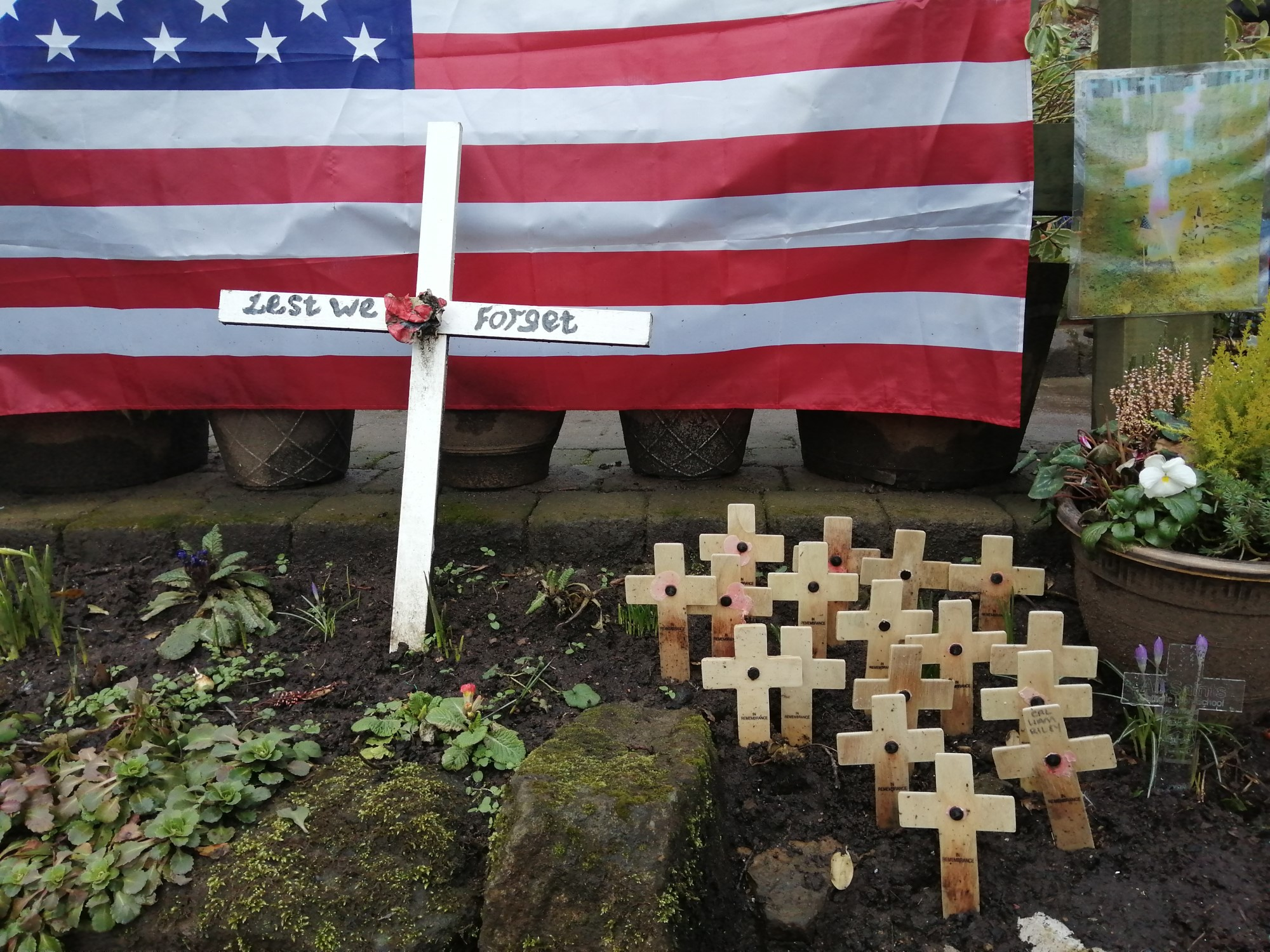 Image of memorial with cross and USA flag